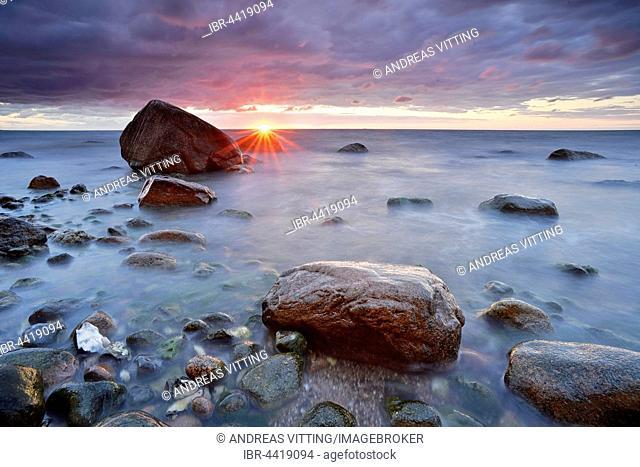 Sunrise, Baltic Sea, boulders in water, Jasmund National Park, Rügen, Mecklenburg-Western Pomerania, Germany