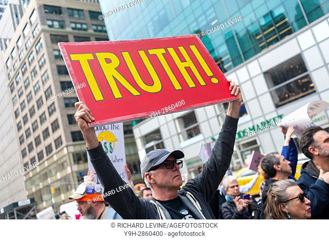 Activists rally in Bryant Park in New York prior to marching to the New York Times building in midtown Manhattan on Saturday, March 25, 2017