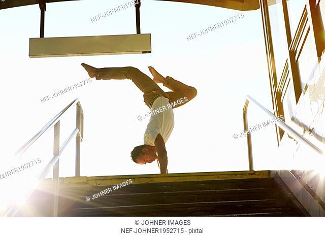 Man doing handstand, New York City, USA