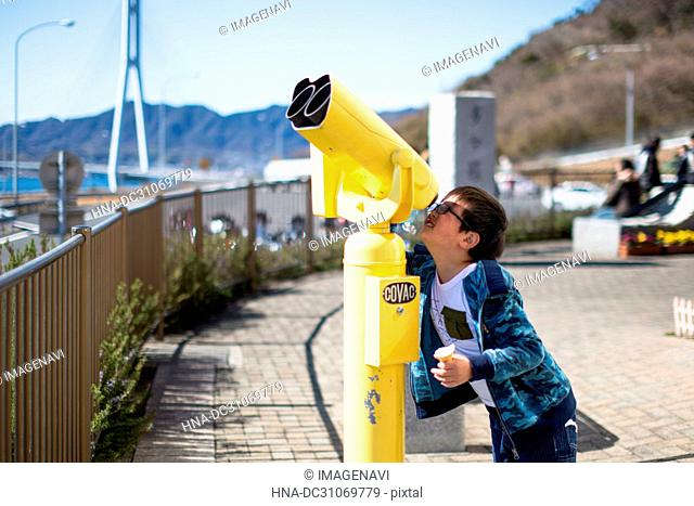 Telescope and boy
