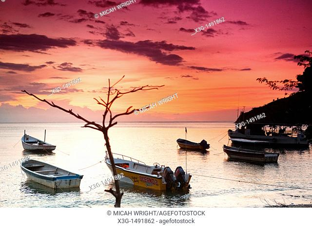 Taganga is a small fishing port on the Caribbean coast of Colombia. Tourism has become a major business in this small village and the sunsets are as beautiful...