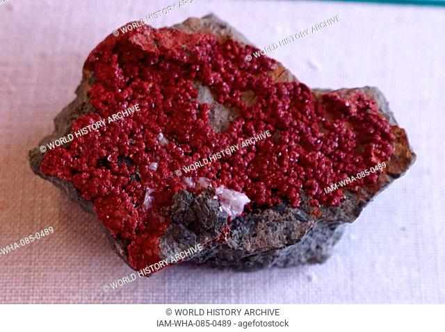 A sample of brick-red tabular crystals. Dated 21st Century