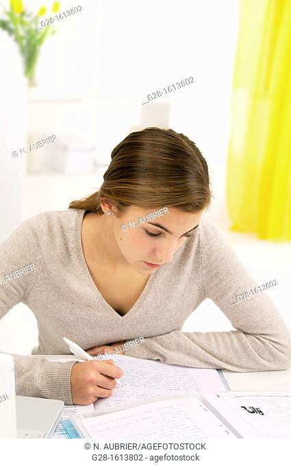 teenage girl doing her homework at home