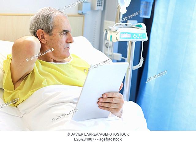 Patient in hospital room with tablet, Hospital