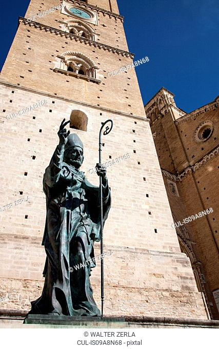 Statue and church tower in Chieti, Abruzzo, Italy