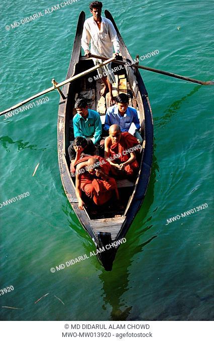 People crossing the Karnaphuli river in Rangamati Bangladesh April 3, 2007