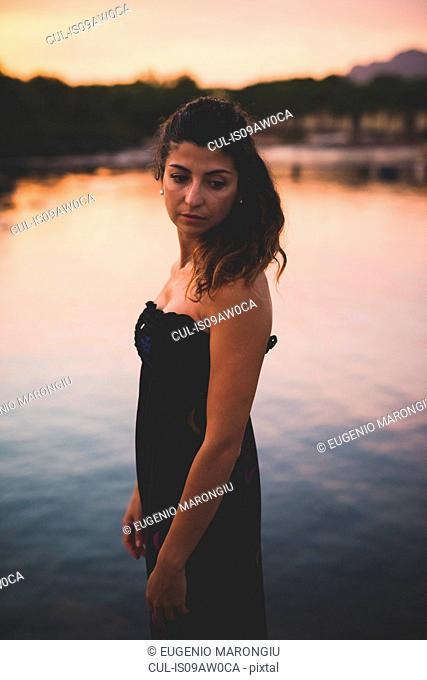 Woman by the sea, wearing long dress
