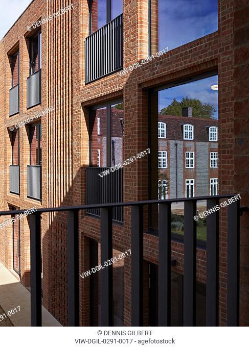 Brick and window pattern with reflection. Newnham College, Cambridge, Cambridge, United Kingdom. Architect: Walters and Cohen Ltd, 2018