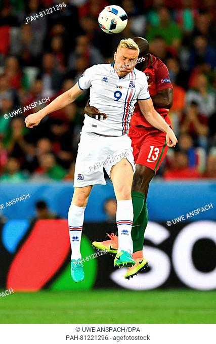 Danilo Pereira (R) of Portugal and Kolbeinn Sigthorsson of Iceland vie for the ball during the UEFA Euro 2016 Group F soccer match Portugal vs