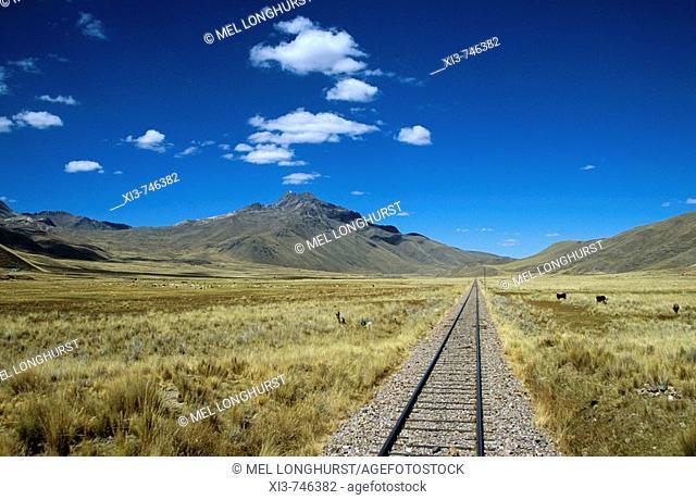 Railway track through the Andes mountain range, Puno to Cusco Perurail train journey, Peru