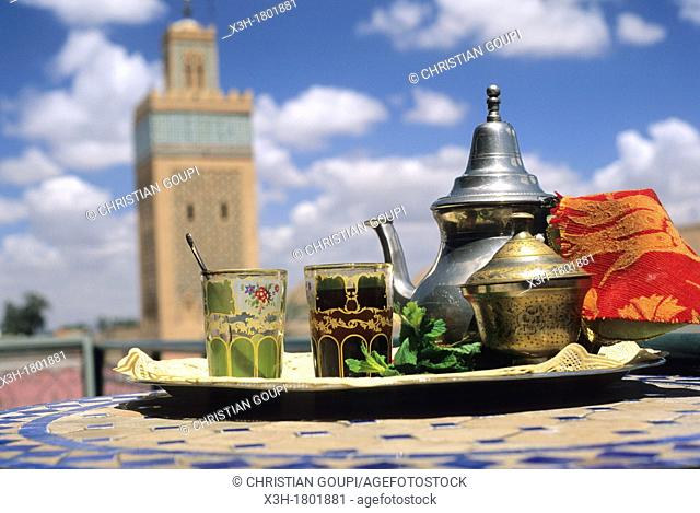 tea set with the Al Mansour mosque background, Marrakech, Atlas, Morocco, North Africa