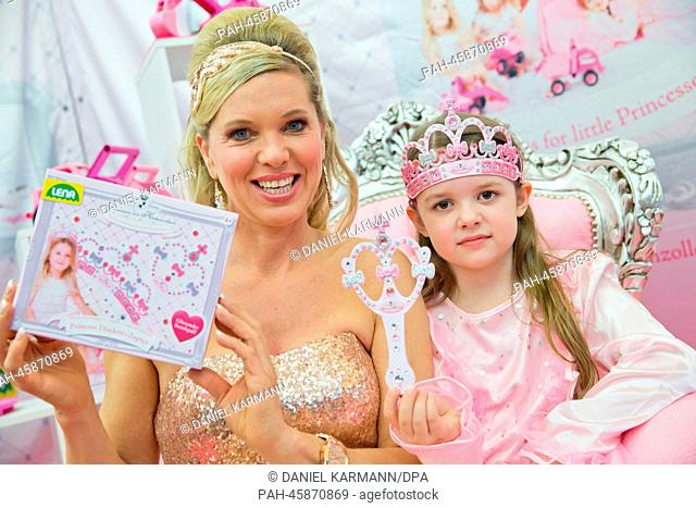 Maja Synke Princess of Hohenzollern presents her new toy collection with little Anna-Katharina during the news show at the 65th International Toy Fair in...