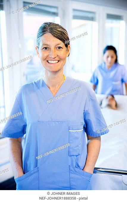 Portrait of smiling doctor in hospital