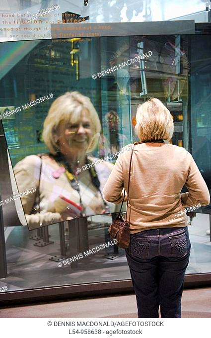 Visitors Demonstrate Innovations of Glass Display Museum of Glass Corning New York Finger Lakes Region