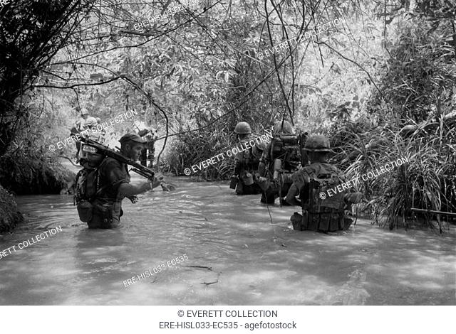 Vietnam War. US Marines move through water in Quang Tri Province during Operation Hastings. During the reconnaissance, search and destroy operation against a...