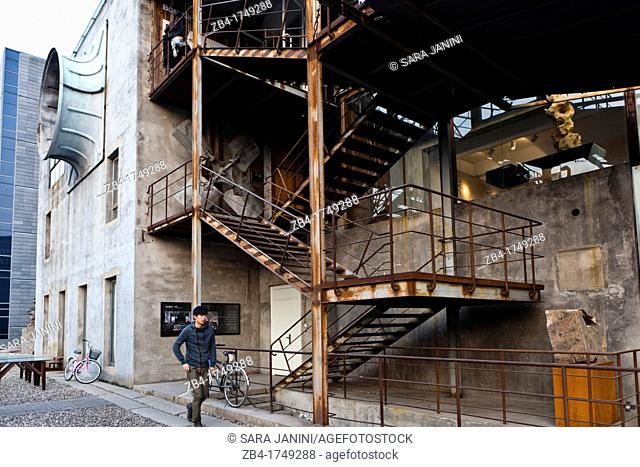 A boy walking in front of old factories of the 751-D Park at 798 Art Zone, a square kilometre of converted industrial site in Beijing's northeastern Chaoyang...