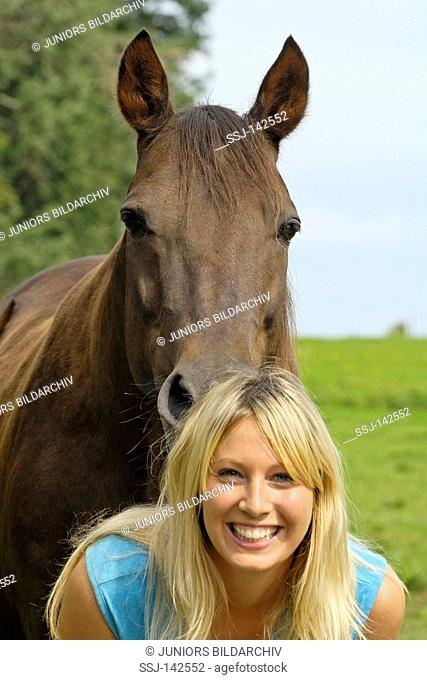 Young lady and her trotter horse