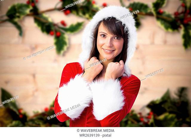 Beautiful woman in santa costume feeling cold