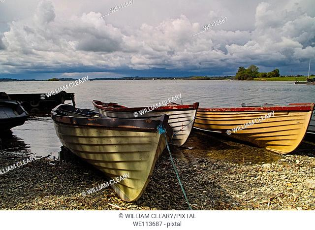 Boats pulled up on the shore of Lough Owel, near Mullingar, County Westmeath, Ireland