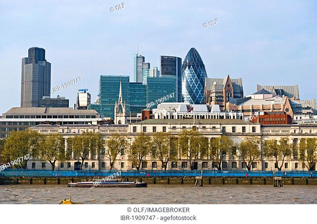 City of London with the office building 30 St. Mary Axe, Swiss-Re Tower or the Gherkin, building designed by architect Sir Norman Foster, London, England