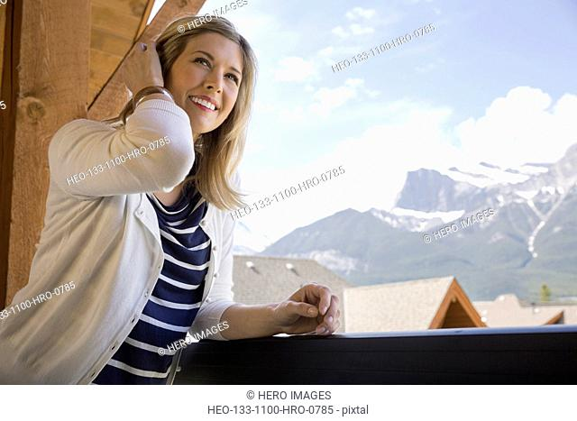 Woman on balcony with mountain view