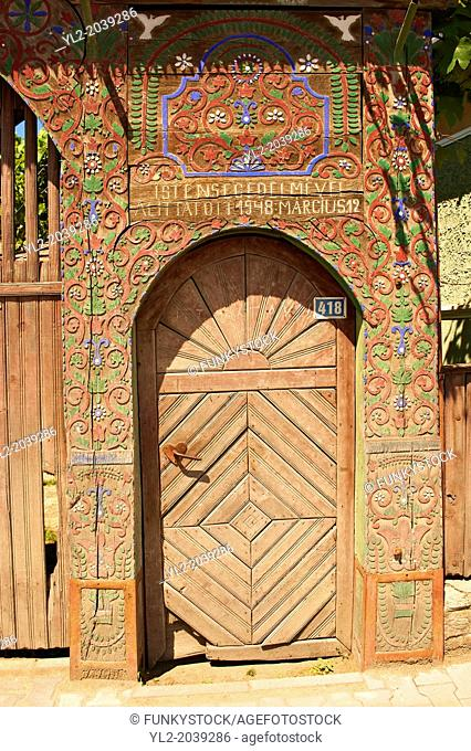 Traditional wooden Szekely gates in a Szekely village near Cluj, Eastern Transylvania. Carved with folk art & painted the Szekely gate also has dove cotes above...