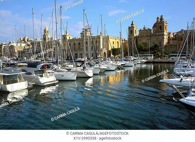 gondolas and boats in the canal of Birgu, Three Cities. Valletta, Malta