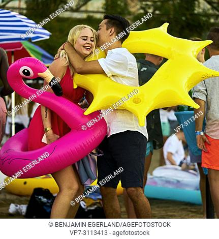 Greece, Crete, Chersonissos, couple at Beach Party, inflatables