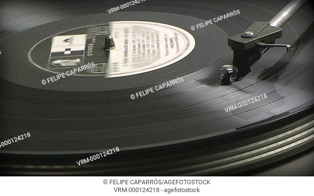 Turntable profile of black 33 rpm record playing on a vinyl record player