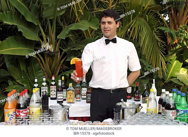 Barkeeper with cocktail in his hand