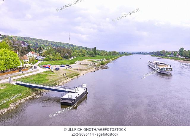 The river cruise ship MS Swiss Ruby goes down the Elbe River and passes the Schiller garden in Dresden-Blasewitz, Dresden, Saxony, Germany