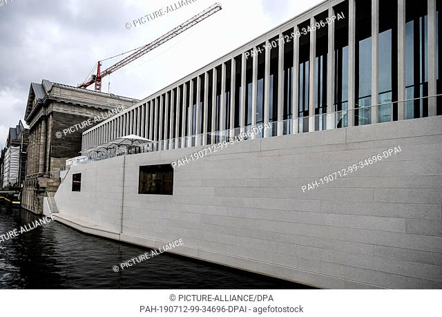 12 July 2019, Berlin: Visitors sit on the terrace of the newly opened James Simon Gallery on Museum Island. Photo: Britta Pedersen/dpa-Zentralbild/dpa