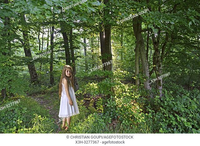 little girl walking around in the Park of the Chateau of Rambouillet, Forest of Rambouillet, Haute Vallee de Chevreuse Regional Natural Park