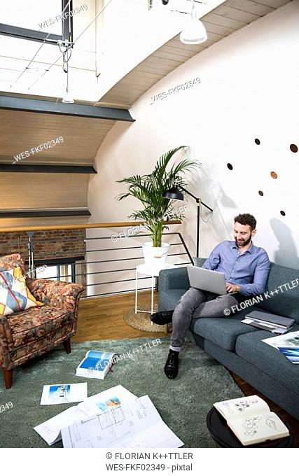 Man working on project in modern office