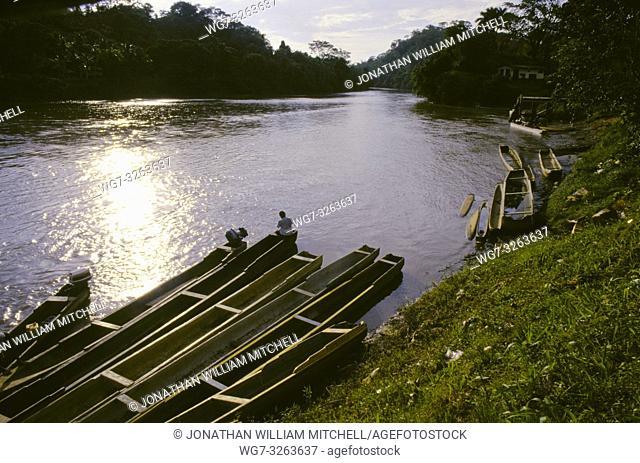 PANAMA Darien Gap, Yaviza. Boatman sits watching the sun set over the Rio Tuira. 10/1997 Picture © Jon Mitchell