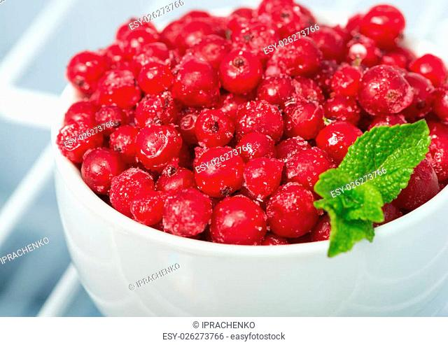 Frozen red currants, cold ripe berry, closeup