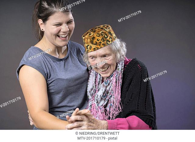 Grandmother and granddaughter dancing holding hands