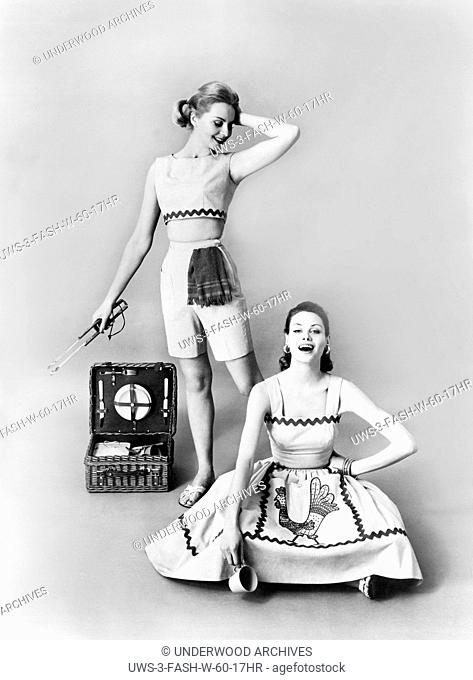 United States: c. 1961 Two models wearing fun and sun-loving cotton oufits for the outdoor barbecue set designed by Ricci of Haymaker