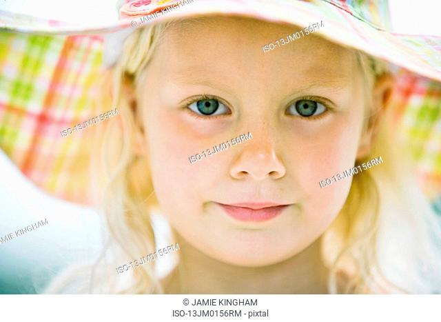 young girl in sun hat
