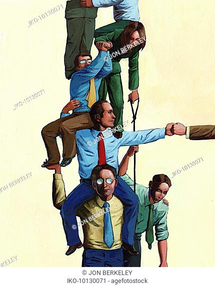 Business people working together to form human pyramid