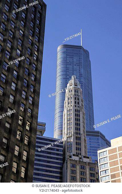 An elegant old tower contrasts with the contemporary architecture of the Trump International Hotel and Tower (completed in 2009.) Chicago, Illinois