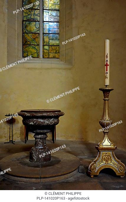 Baptismal font and Paschal candle in the Nevers Cathedral / Cathédrale Saint-Cyr-et-Sainte-Julitte de Nevers, Burgundy, France