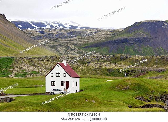 House at the base of Mt. Stapafell (left) and Snaefellsjokull Glacier (back) in Arnastapi, Snaefellsnes Peninsula, Iceland