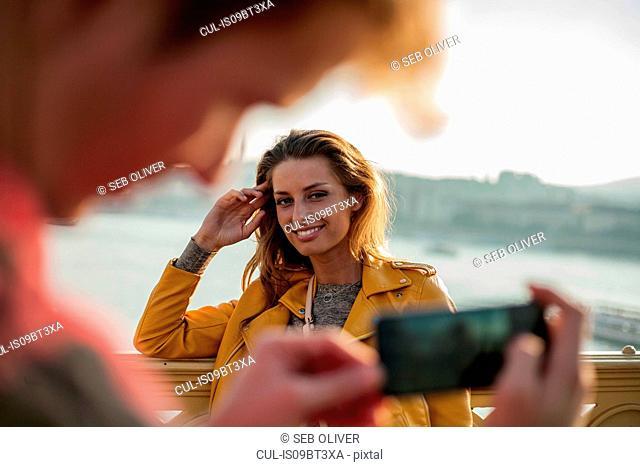 Couple taking photos using smartphone