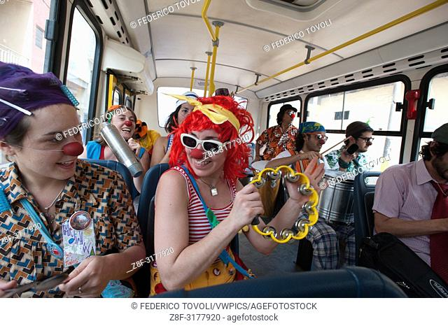 The group clowns on the bus that takes them in various places to visit in Iquitos. Peru