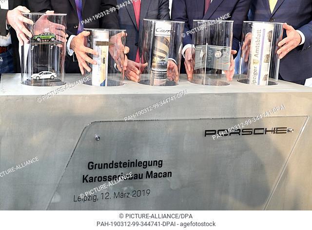 12 March 2019, Saxony, Leipzig: Knut Lofski, Chairman of the Works Council of Porsche Leipzig GmbH (l-r), Albrecht Reimold