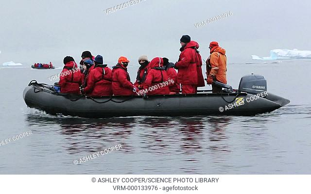 Passengers from an expedition cruise ship off Curverville Island in Antarctica
