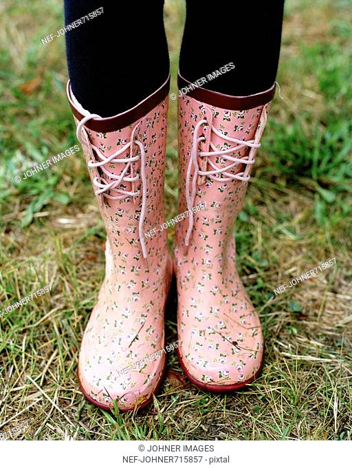 A pair of pink wellingtons, Sweden