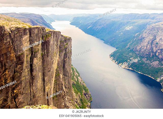Aerial view of Lysefjorden from the mountain Kjerag, with waterfall on the cliff and mountains in background, in Forsand municipality in Rogaland county, Norway
