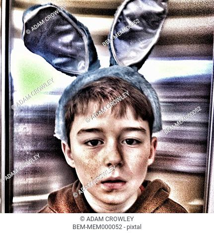 Caucasian boy in rabbit ears
